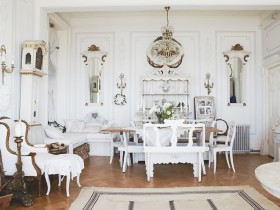 White living room with antique furniture