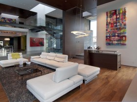 White sofas on the background of the living room in modern style