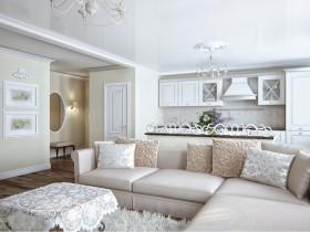 Белая кухня, совмещенная с гостиной комнатой