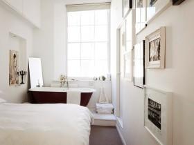 White bedroom with black bathtub