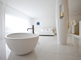 White bedroom with bathroom in minimalist style