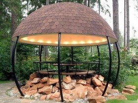 Modern spherical garden furniture made of metal