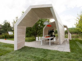 White wooden gazebo in the style of deconstructivism