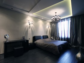 Dark bedroom with tiered ceiling and beautiful bathroom fixture