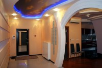 Entrance hall in the style of hi-tech with hidden ceiling light