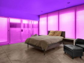 Modern bedroom with pink backlight