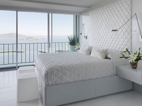 The interior of white bedrooms with large Windows