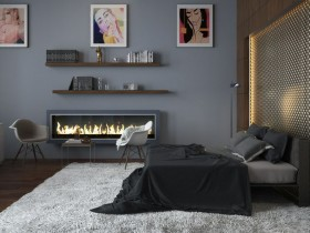 Dark master bedroom with fireplace