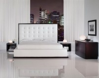 White bedroom with glossy flooring