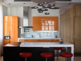 Orange and white kitchen in modern style