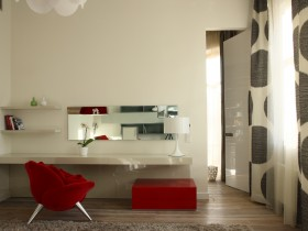 The interior is bright bedrooms with red chair