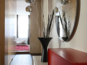 A narrow corridor with mirror in modern style