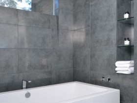 Modern bathroom in white and grey color