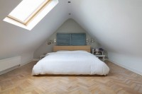 Small light bedroom with sloping ceiling