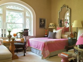 Bright bedroom in Oriental style with pink bedding on the bed