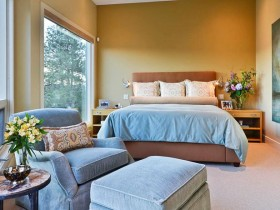 Bedroom with peach walls and blue furniture