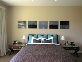 The idea of the bedroom design in warm shades