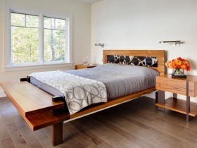 Bright bedroom with parquet flooring and wooden furniture