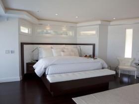 White bedroom with black floor