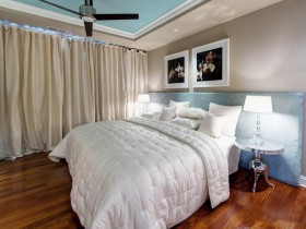 Bedroom in warm shades with light curtains