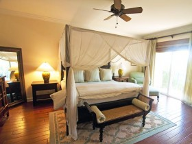 Beautiful bedroom in warm tones with four poster bed
