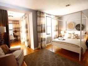 Совмещенная спальня в теплых оттенках