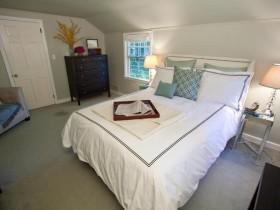 Spacious bedroom in light grey color