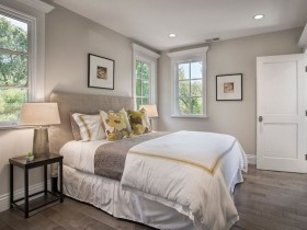 Light grey bedroom with white bed