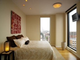 Small bright bedroom with large Windows
