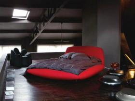 Dark bedroom with red bed