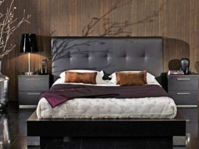 Dark bedroom with wooden walls