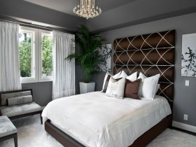 The contrast of white with dark gray interior bedroom