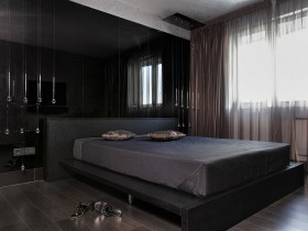 Modern black bedroom with gray ceiling
