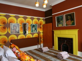 Master bedroom with fireplace in the style of kitsch