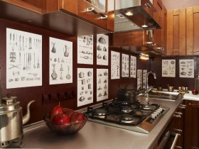 Kitchen with wooden furniture and posters, kitchen ware