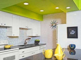 Bright kitchen with green tiered ceiling