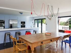Bright kitchen with wooden table and original chandelier