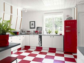 White kitchen with red refrigerator and chess tile