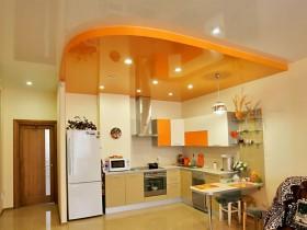 Modern bright kitchen with orange ceiling