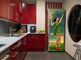 The red-and-white kitchen with colorful refrigerator