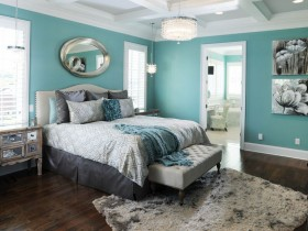 Bedroom in turquoise color with white coffered ceiling