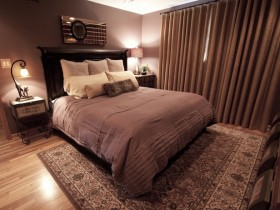 Dark bedroom with elements of Safari style