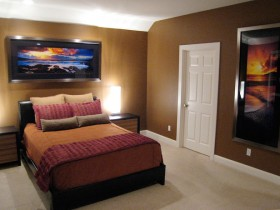 Dark modern bedroom with mural
