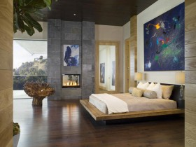 Modern bedroom design with fireplace in eclectic style