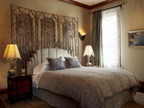 Bedroom interior with elements of the Romanesque style
