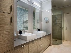 Large bathroom with wooden furniture, two sinks