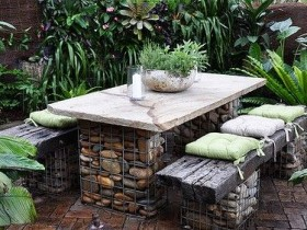 Table and chairs of gabions