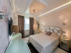 Bright bedroom with suspended ceiling and the original bed