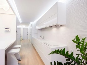 The design of the white kitchen in the apartment