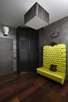 Black hallway with a bright green sofa